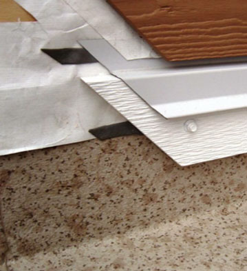 Image of the outside edge of different vinyl decking materials